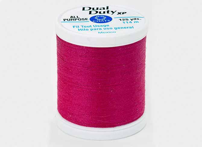 a spool of Coats Dual Duty XP All Purpose Thread spool