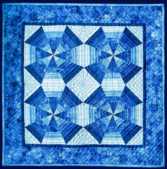 Kaleidoscope quilt in a cool monochromatic color scheme
