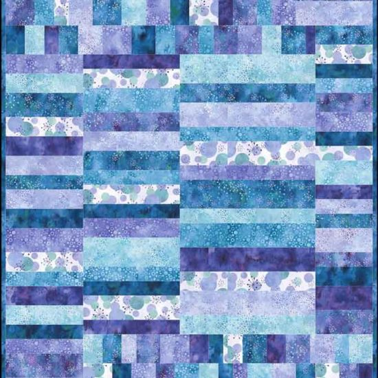 Modern baby quilt using the purple Cosmic Fusion fabric from Northcott