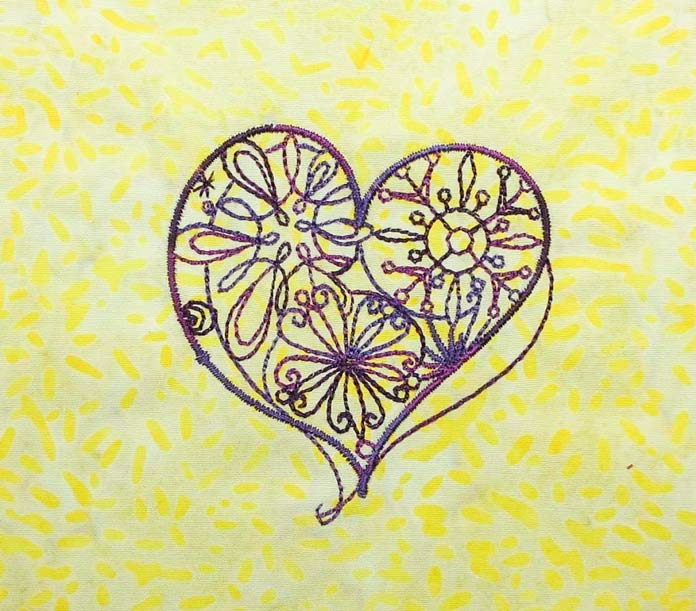 Machine embroidered heart design from the design library on THE Dream Machine 2