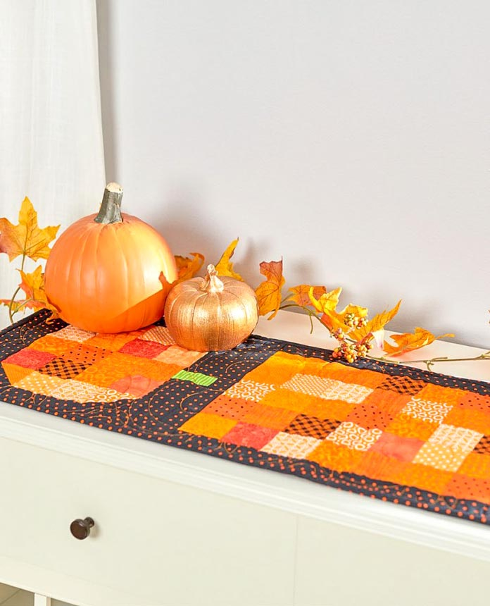 Thinking of fall, a quilted Halloween Runner