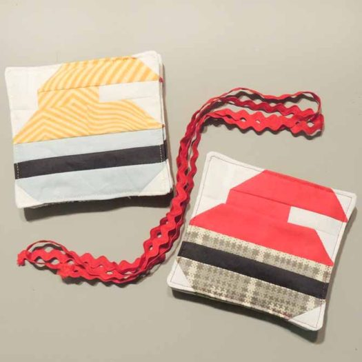 two sets of curling rock coasters and ric rac garland supplies