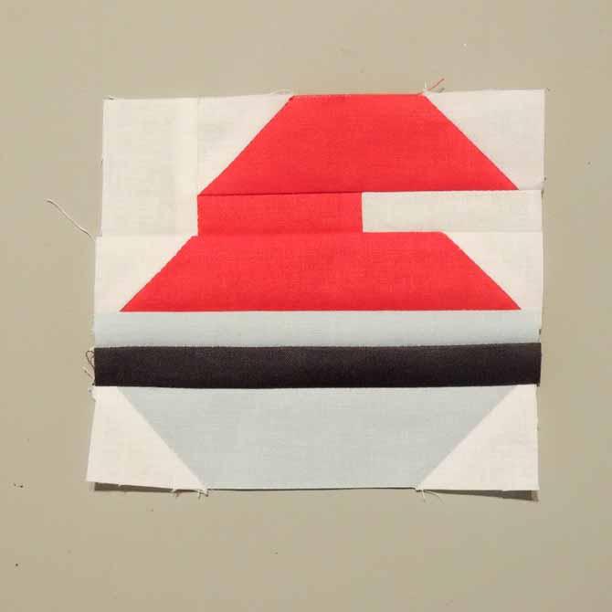 curling rock block pieced quilt block