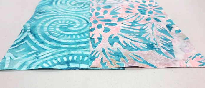 "Overlap the long sides of the strips by about 1"" to prepare for curved strip piecing; using Banyan Batiks Island Vibes fabrics."