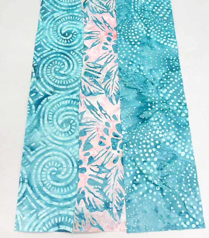 3 curved strips sewn together; using Banyan Batiks Island Vibes fabrics