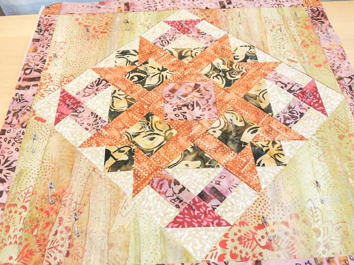 Cushion cover pinned for quilting.
