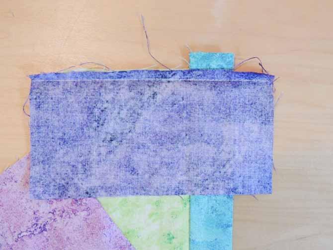 Excess seam to trim crazy patch potholder