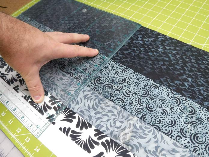 "The Banyan Batiks Banyan Classics Collection Rail Fence quilt comes to life as the strip sets are cut into 12½"" square blocks. Free pattern"