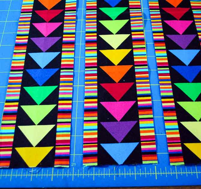 Cutting the flying geese fabric into strips