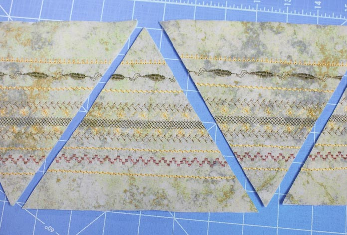 Trim the fabric into a strip and cut 60° triangles.