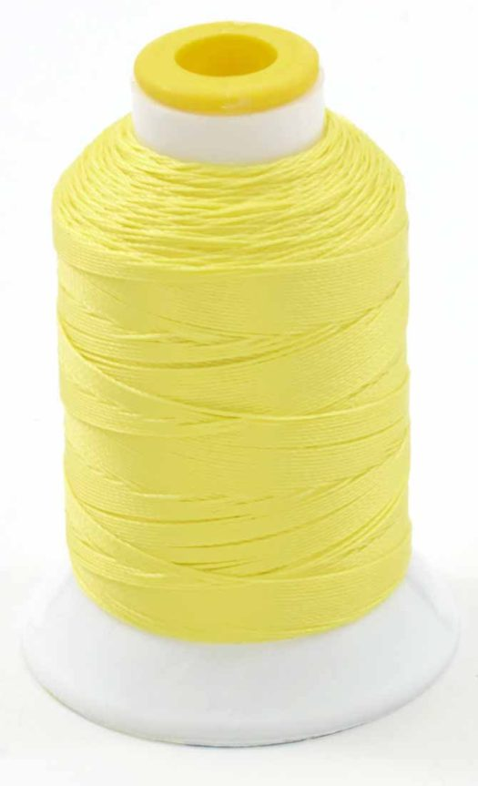 200yd spool of Coats Outdoor Thread in bright yellow! See the benefits of making patio decor with this weather resistant thread.