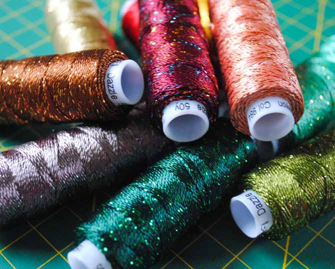 A selection of colorful Dazzle threads from WonderFil Specialty threads.