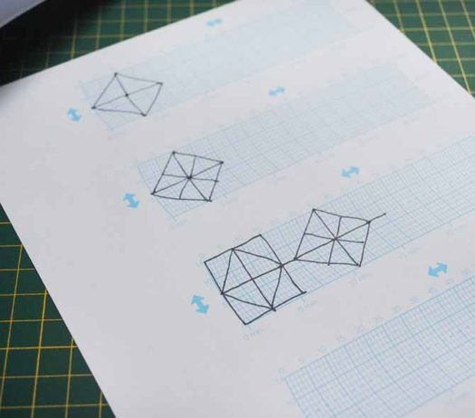 The first step for My Custom Stitch is to draw your design on the grid sheet.