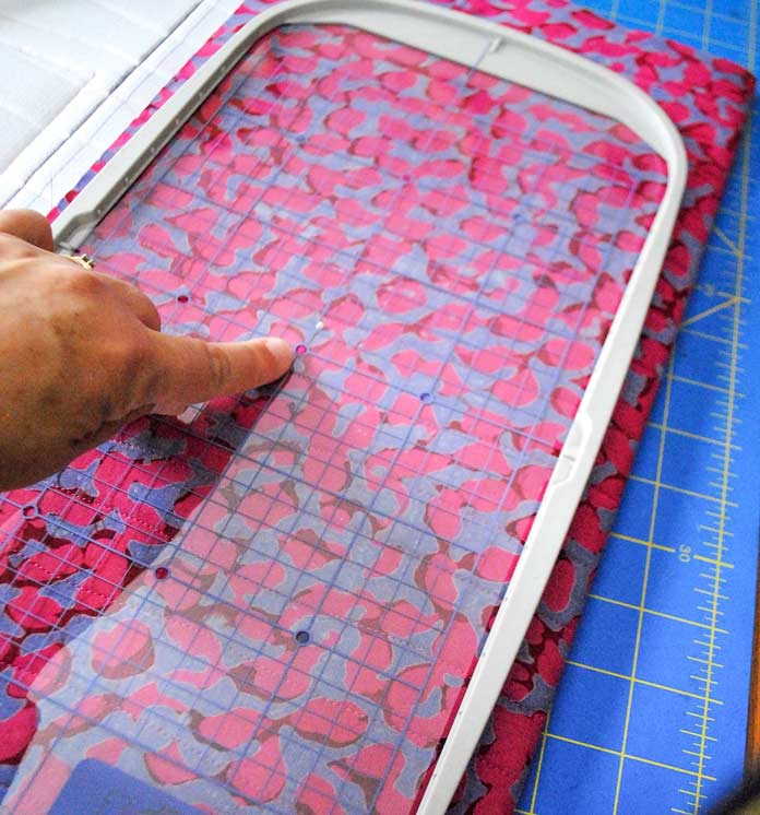 Aligning the embroidery sheet