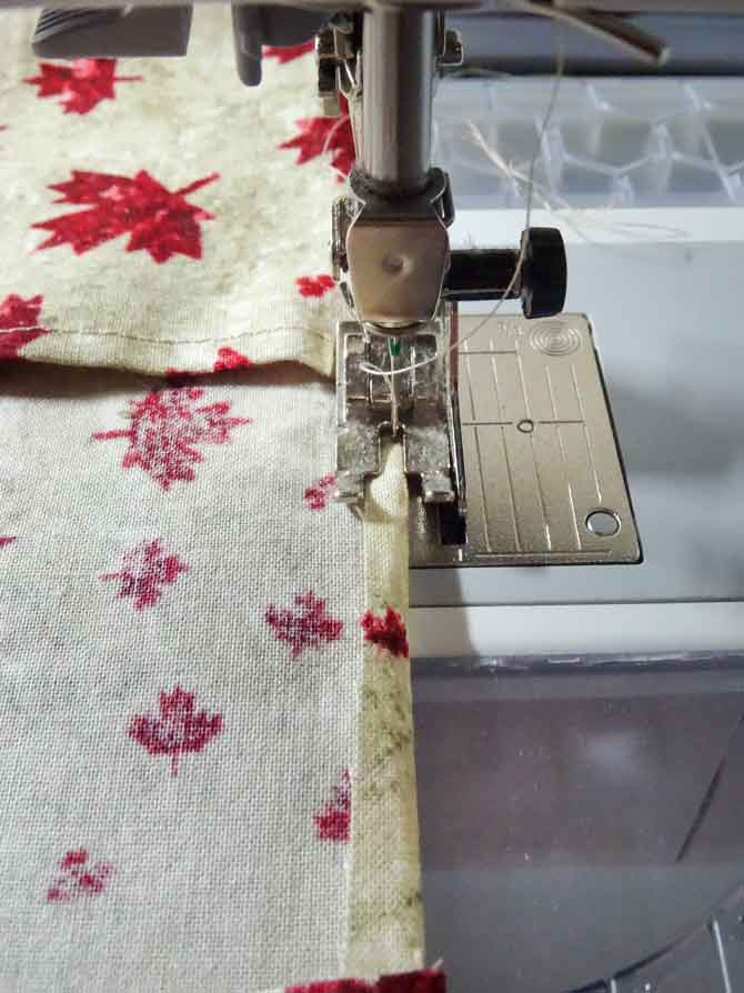Sewing down the small flap between inside pieces