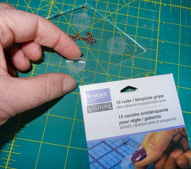Applying a rubber curcular grip to the bottom of a ruler.