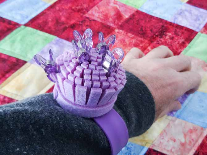 A Clover's handy Wonder Clips wrist cushion is used to clip clever clips as they are used or to retrive them as they are needed,