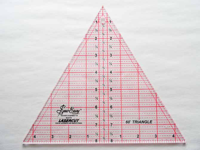 A SEW EASY® Triangle Ruler 60° that will be used to make a hexagon quilt.