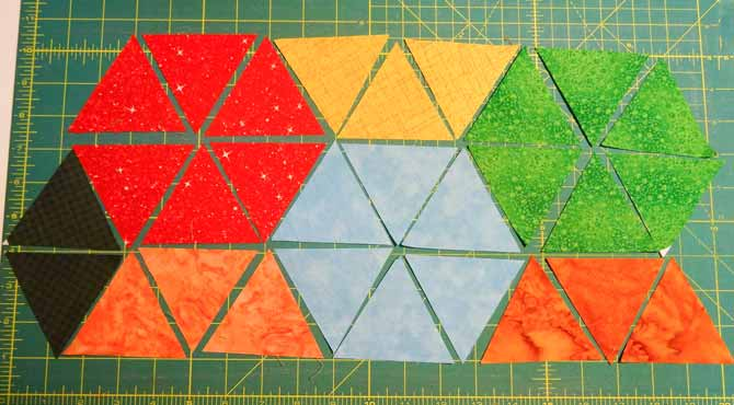 the triangles where palced in row with the colors place in a way to form hexagons once sewn.