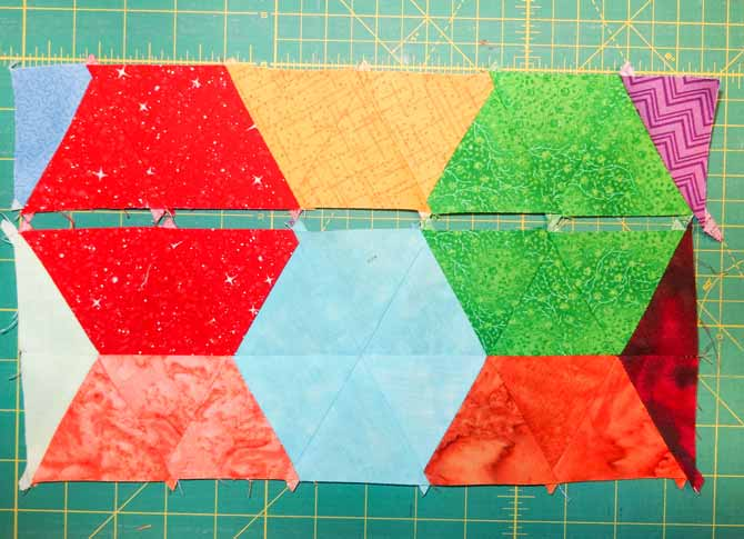 triangles cut out of fabric sewn together to make hexagons