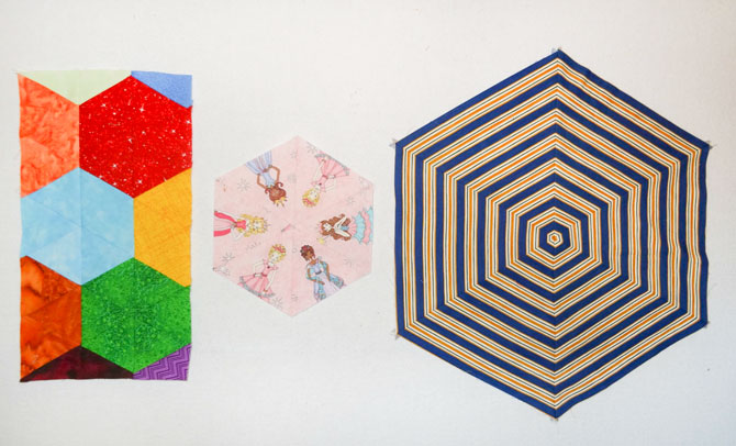 Three different hexagons that were made by fussy cutting fabrics using the Sew Easy ruler to make 60° triangle shapes.