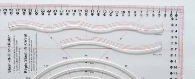 The Komfort KUT Slash-N-Circle section of the ruler showing the two possible curves that the ruler offers.