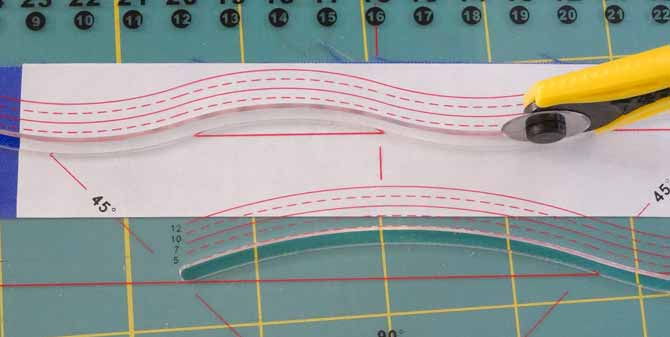 A first curve is being cut using the Komfort KUT Slash-N-Circle Ruler.