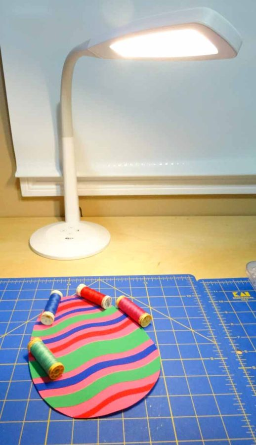 Use the SURElight desk lamp to provide the lighting you need to finish your Easter egg quilt. Komfort KUT Slash-N-Circle Ruler.