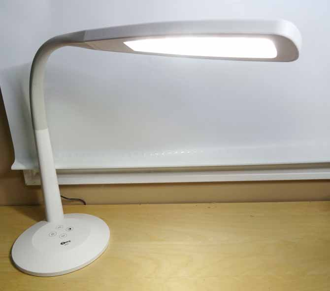The Surelight M4T LED Desk Lamp positioned to light the desk top.