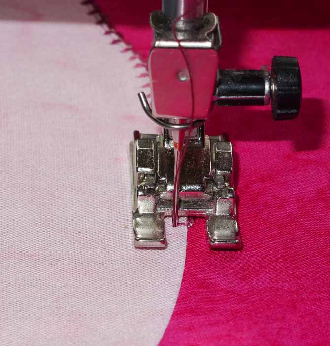 Sewing a double blind hem stitch to secure the applique piece in place. WonderFil DecoBob Prewound Bobbins.