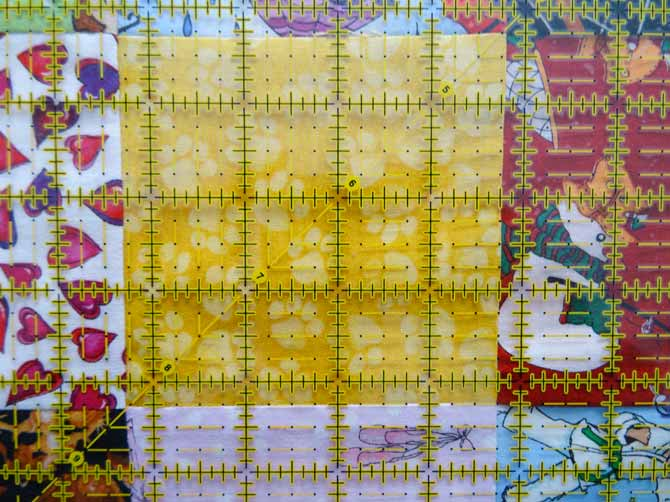 The diagonal line of the OMNIGRID ruler goes from corner to corner and assists in the squaring of a quilt block.
