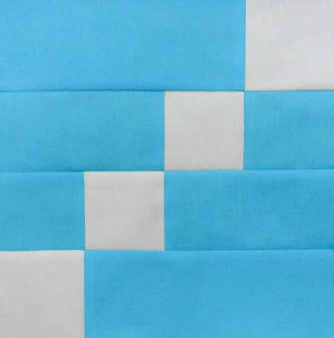 A completed quilt block in turquoise and off white will give you multiple layout possibilities for any quilt size you would want to make.