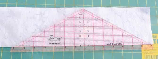 "The 4"" mark of the SEW EASY Half Diamond Ruler is aligned with the fold of the fabric."