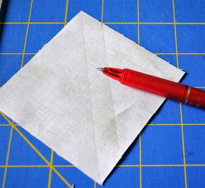Marking the back of the squares for making flying geese blocks