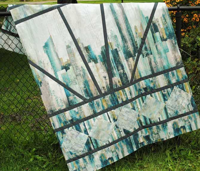 The finished Artisan Spirit City Scene lap quilt.