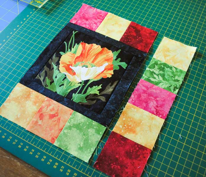 The same strip of Full Bloom fabrics flipped end for end will work perfectly for the first side of the block.