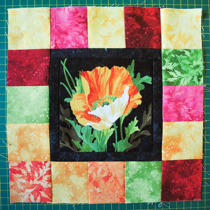 The pieced quilt block made with fabrics from the Full Bloom line from Northcott.