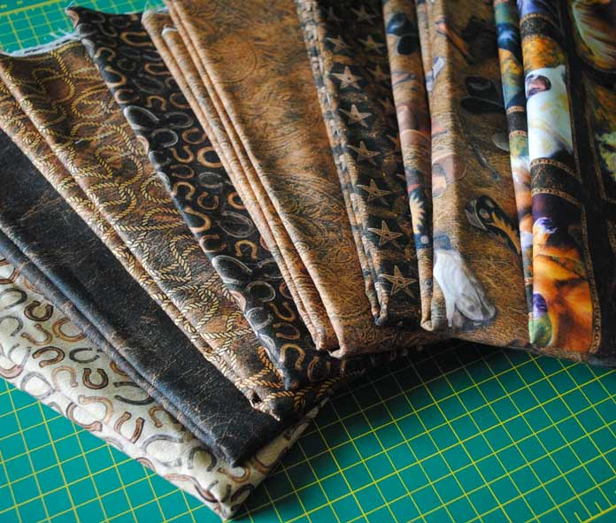 An assortment of fabrics from the WIld and Free fabric line from Northcott.
