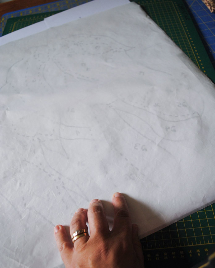Trace sections onto paper side of fusible web.