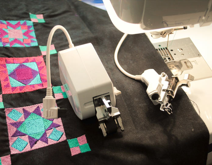 The dual feed foot and embroidery W+ foot
