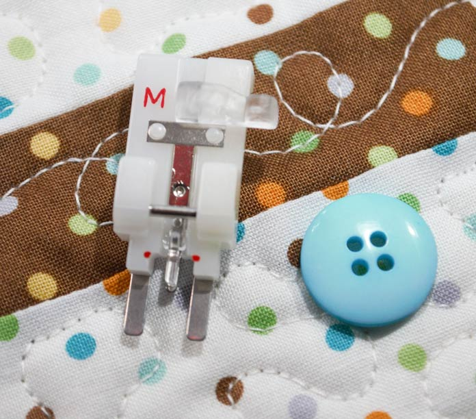 "The button sewing foot ""M"""