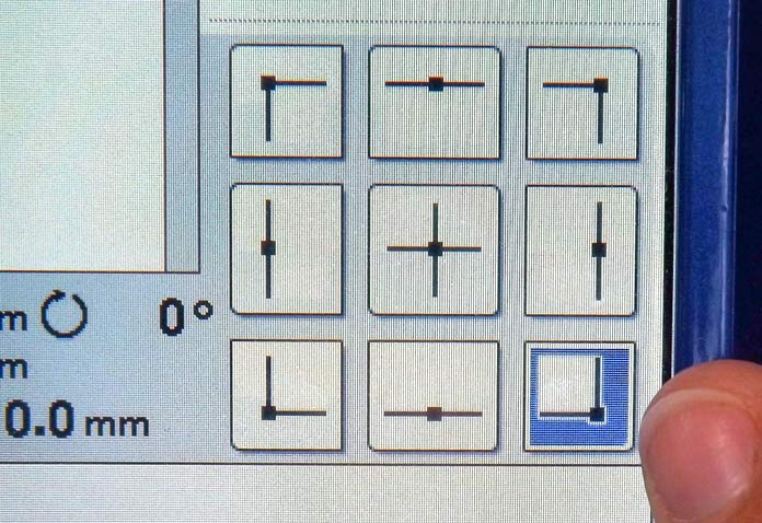 Select the desired position on the arrow chart and the embroidery frame of the Dreamweaver XE moves to that spot to check that there is enough space to sew the pattern.  A tutorial on how to make quilt labels using machine embroidery and ribbons using the Brother Dreamweaver XE