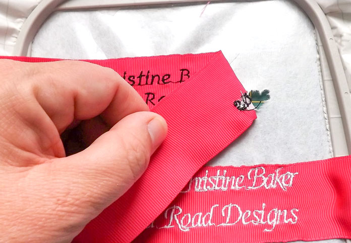 Pull the embroidered ribbon off of the stabilizer sheet and remove excess stabilizer from the back of the ribbon. A tutorial on how to make quilt labels using machine embroidery and ribbons using the Brother Dreamweaver XE