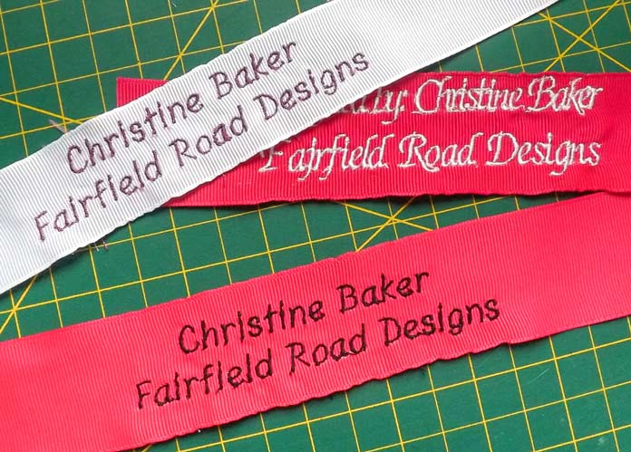 Here are the three ribbons that were embroidered with words using the Dreamweaver XE from Brother. A tutorial on how to make quilt labels using machine embroidery and ribbons using the Brother Dreamweaver XE