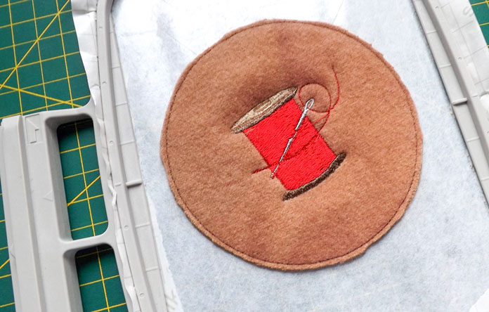 Trim close to the stitching line with small sharp scissors, being careful to not clip the stabilizer or the stitching.