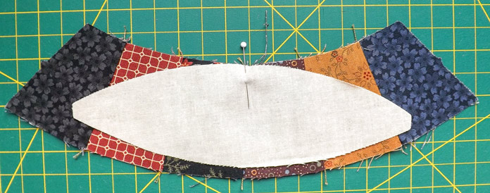 Pin to center of pieced arc