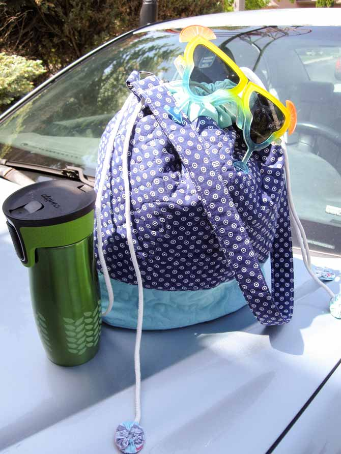 This easy-breezy bucket bag is perfect for summer fun and road trips! (Please enjoy responsibly.)