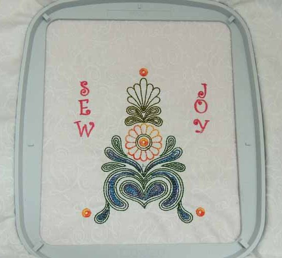 Embroidery design stitched out in hoop.