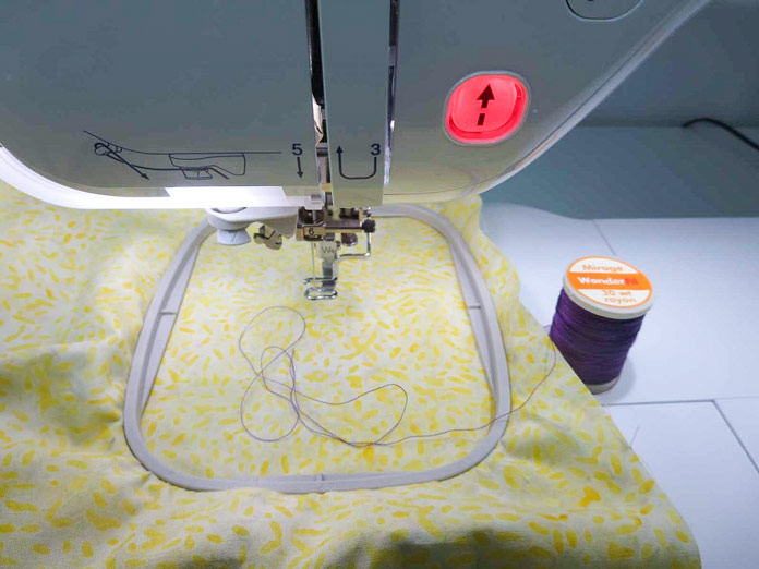 Hooped fabric attached to the embroidery frame