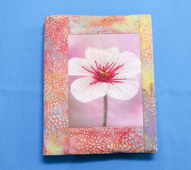 The finished journal cover with a thread painted photo stitched with WonderFil rayon threads.